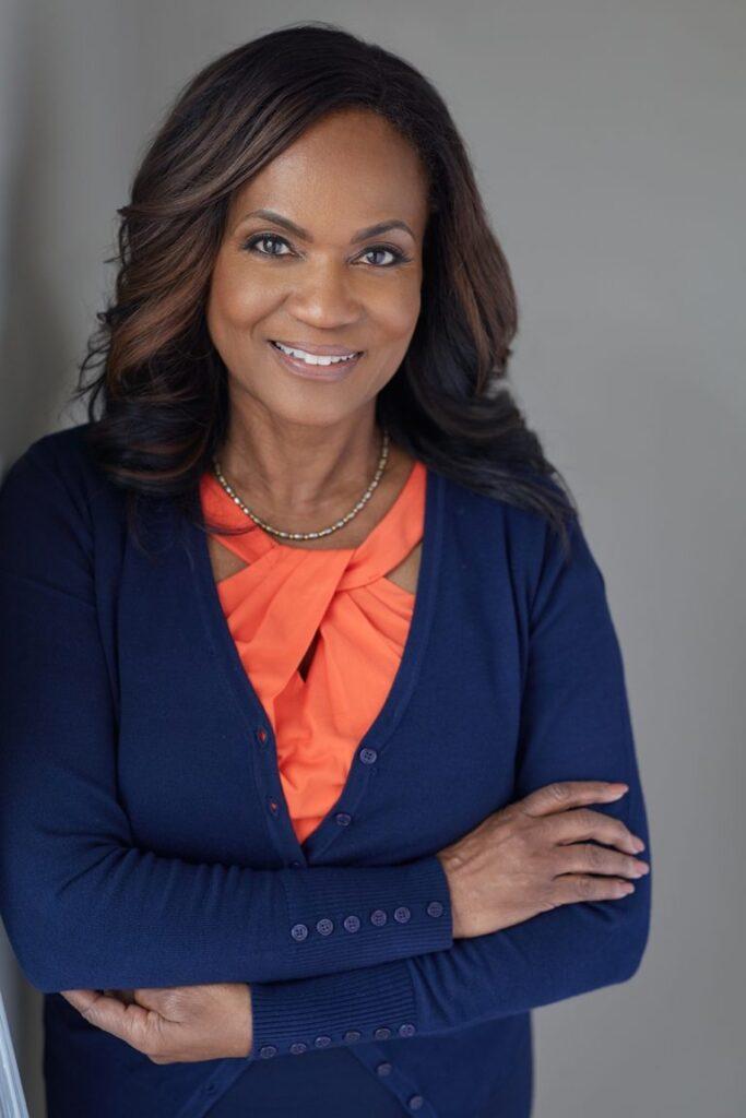 Gloria Thomas Anderson profile, arms crossed